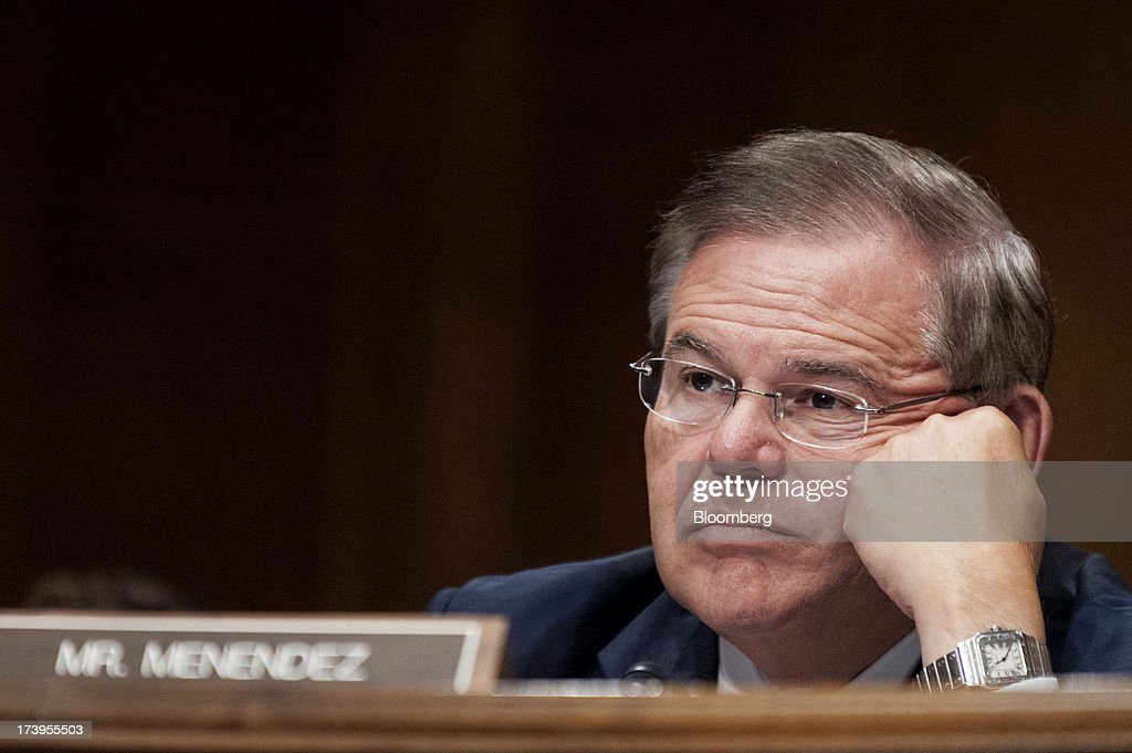 Senator <a gi-track='captionPersonalityLinkClicked' href=/galleries/search?phrase=Robert+Menendez&family=editorial&specificpeople=504931 ng-click='$event.stopPropagation()'>Robert Menendez</a>, a Democrat from New Jersey, listens as Ben S. Bernanke, chairman of the U.S. Federal Reserve, not seen, delivers his semi-annual monetary policy report to the Senate Banking, Housing, and Urban Affairs Committee in Washington, D.C., U.S., on Thursday, July 18, 2013. Bernanke said one reason for the recent rise in long-term interest rates is the unwinding of leveraged and 'excessively risky' investing. Photographer: Pete Marovich/Bloomberg via Getty Images