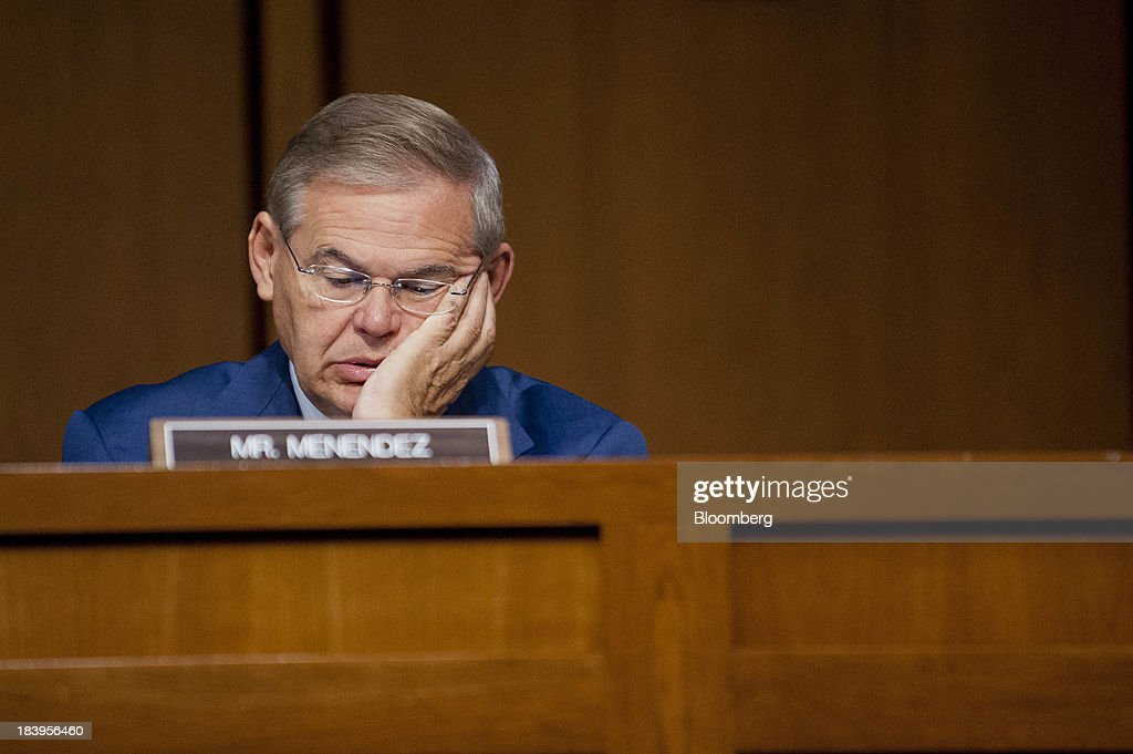 Senator <a gi-track='captionPersonalityLinkClicked' href=/galleries/search?phrase=Robert+Menendez&family=editorial&specificpeople=504931 ng-click='$event.stopPropagation()'>Robert Menendez</a>, a Democrat from New Jersey, listens to testimony during a Senate Finance Committee hearing on Capitol Hill in Washington, D.C., U.S., on Thursday, Oct.10, 2013. Treasury Secretary Jacob Lew warned that the congressional deadlock over the U.S. debt ceiling is 'beginning to stress the financial markets,' and failing to raise it by Oct. 17 could put Social Security and Medicare payments at risk. Photographer: Pete Marovich/Bloomberg via Getty Images