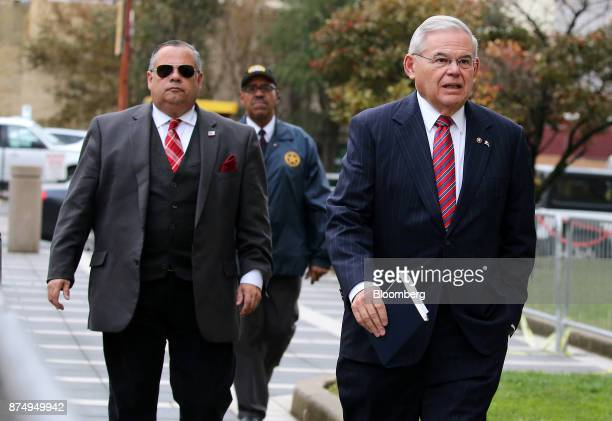 Senator Robert Menendez a Democrat from New Jersey right arrives at federal court in Newark New Jersey US on Thursday Nov 16 2017 Jurors at the...