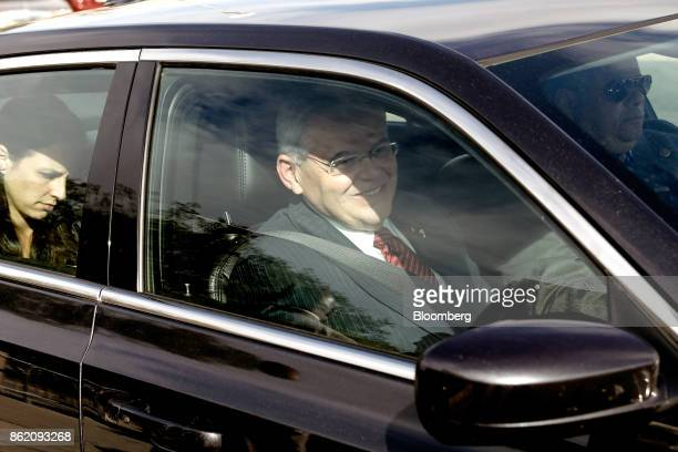 Senator Robert Menendez a Democrat from New Jersey sits in a vehicle while leaving federal court in Newark New Jersey US Monday Oct 16 2017 The...