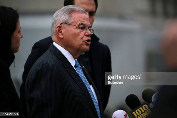 Senator Robert Menendez a Democrat from New Jersey speaks to members of the media while exiting federal court in Newark New Jersey US on Wednesday...
