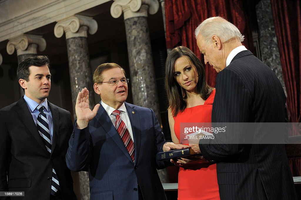 US Senator Robert Menendez, D-NJ (2L) participates in a reenacted swearing-in with his son Robert Menendez and daughter Alicia Jacobsen Menendez and US Vice President Joe Biden in the Old Senate Chamber at the U.S. Capitol January 3, 2013 in Washington, DC. The 113th US Congress, featuring dozens of new faces in the House and Senate, convened Thursday fresh from the year-end 'fiscal cliff' fiasco, as lawmakers cast a wary eye towards the tough budget battles ahead. AFP PHOTO / Jewel Samad