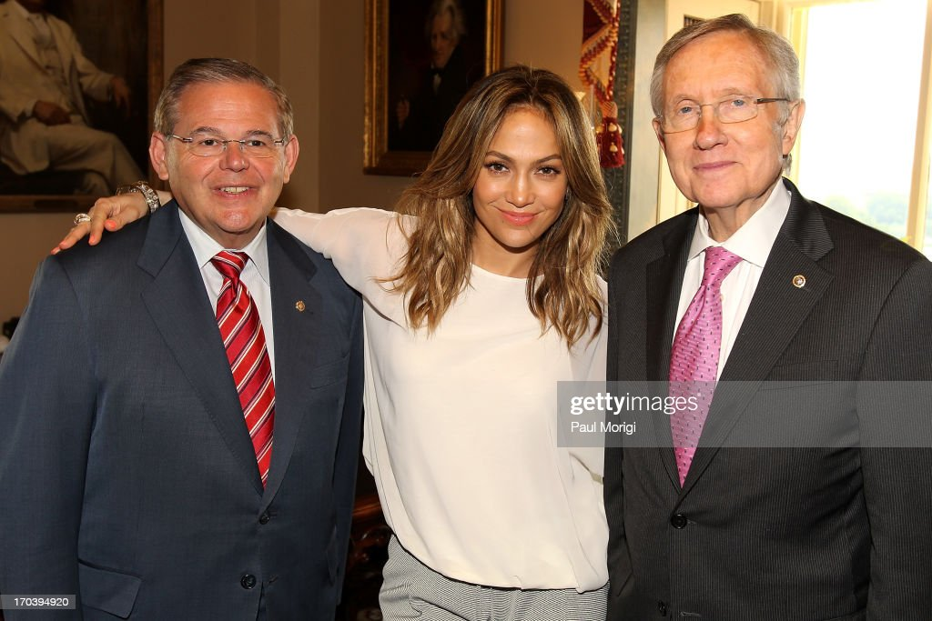 Senator <a gi-track='captionPersonalityLinkClicked' href=/galleries/search?phrase=Robert+Menendez&family=editorial&specificpeople=504931 ng-click='$event.stopPropagation()'>Robert Menendez</a>, NUVOtv Chief Creative Officer <a gi-track='captionPersonalityLinkClicked' href=/galleries/search?phrase=Jennifer+Lopez&family=editorial&specificpeople=201784 ng-click='$event.stopPropagation()'>Jennifer Lopez</a> and Senate Majority Leader <a gi-track='captionPersonalityLinkClicked' href=/galleries/search?phrase=Harry+Reid+-+Politician&family=editorial&specificpeople=203136 ng-click='$event.stopPropagation()'>Harry Reid</a> meet on Capitol Hill on June 12, 2013 in Washington, DC.