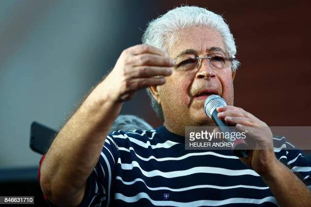 Senator Roberto Requiao speaks during a demonstration by supporters of former president Luis Inacio Lula da Silva at Generoso Marques Square in...