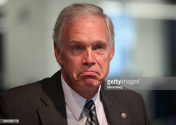 Senator Ron Johnson a Republican from Wisconsin pauses during an interview in Washington DC US on Friday Oct 11 2013 Johnson said at a Bloomberg...