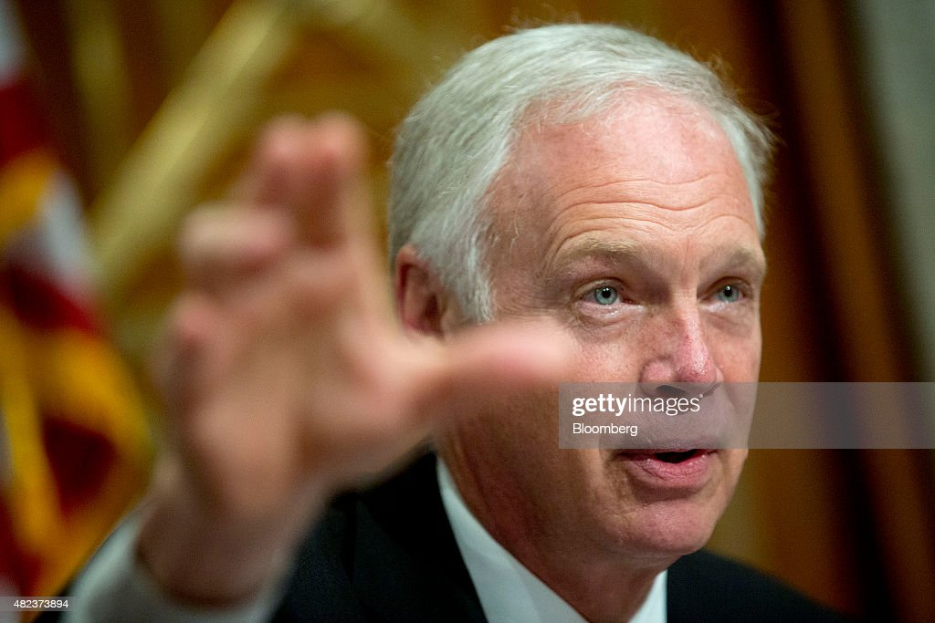 Senator <a gi-track='captionPersonalityLinkClicked' href=/galleries/search?phrase=Ron+Johnson+-+Politician&family=editorial&specificpeople=12902569 ng-click='$event.stopPropagation()'>Ron Johnson</a>, a Republican from Wisconsin, questions witnesses during a Senate Permanent Subcommittee on Investigations hearing in Washington, D.C., U.S., on Thursday, July 30, 2015. The subcommittee held its first hearing under new leadership on today with a dive into the U.S. corporate tax code. Congress has been considering an overhaul of the code, prompted in part by U.S. companies shifting their legal addresses abroad to take advantage of lower corporate tax rates. Photographer: Andrew Harrer/Bloomberg via Getty Images
