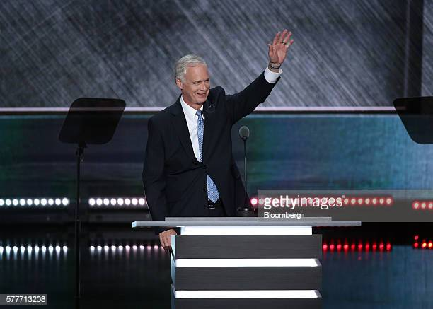 Senator Ron Johnson a Republican from Wisconsin waves while speaking during the Republican National Convention in Cleveland Ohio US on Tuesday July...