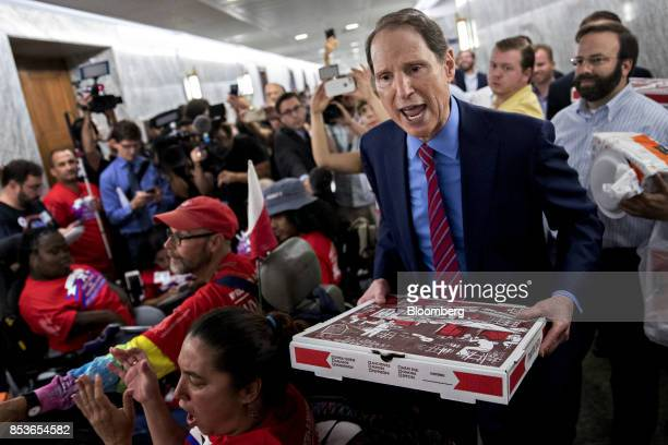 Senator Ron Wyden a Democrat from Oregon and ranking member of the Senate Finance Committee speaks while delivering pizza to disability rights group...