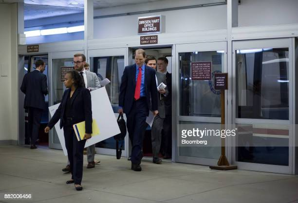 Senator Ron Wyden a Democrat from Oregon and ranking member of the Senate Finance Committee center exits the Senate subway at the US Capitol in...