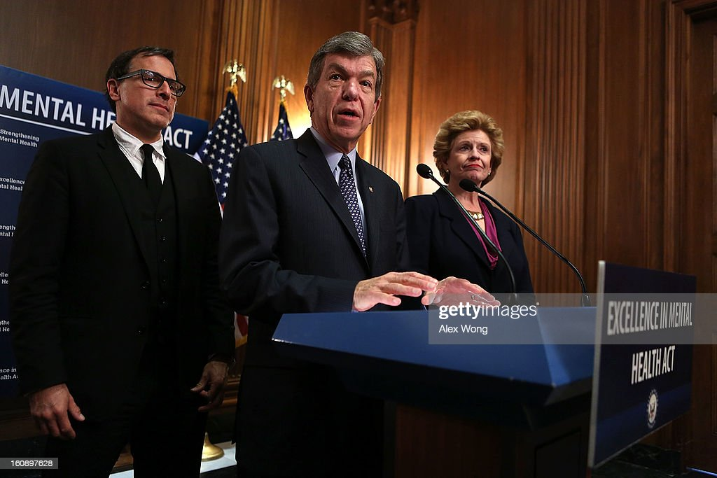 U.S. Senator <a gi-track='captionPersonalityLinkClicked' href=/galleries/search?phrase=Roy+Blunt&family=editorial&specificpeople=233679 ng-click='$event.stopPropagation()'>Roy Blunt</a> (R-MO) speaks as <a gi-track='captionPersonalityLinkClicked' href=/galleries/search?phrase=David+O.+Russell&family=editorial&specificpeople=215306 ng-click='$event.stopPropagation()'>David O. Russell</a>, director of the film Silver Linings Playbook (L), and Senator <a gi-track='captionPersonalityLinkClicked' href=/galleries/search?phrase=Debbie+Stabenow&family=editorial&specificpeople=221624 ng-click='$event.stopPropagation()'>Debbie Stabenow</a> (D-MI) look on during a news conference February 7, 2013 on Capitol Hill in Washington, DC. A bipartisan group of senators will introduce the Excellence in Mental Health Act to help strengthen the nation's mental health services.