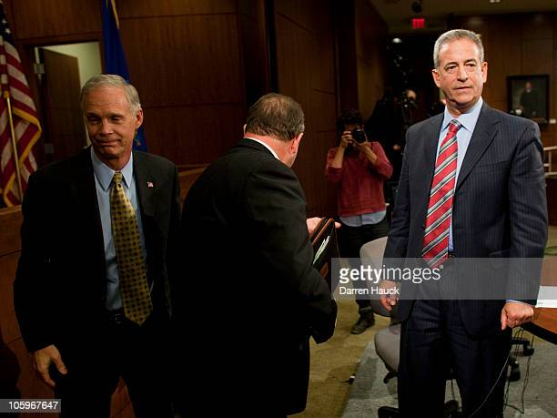 Senator Russ Feingold and Republican candidate Ron Johnson leave the stage after they took part in the Senatorial debate held at Marquette University...
