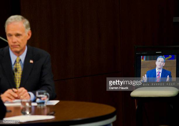 Senator Russ Feingold is seen on a closed circuit television as he debates with Republican candidate Ron Johnson at Marquette University Law School...