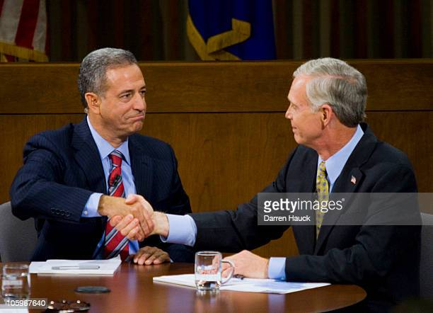 Senator Russ Feingold shakes hands with Republican candidate Ron Johnson after they took part in a Senatorial debate held at Marquette University Law...