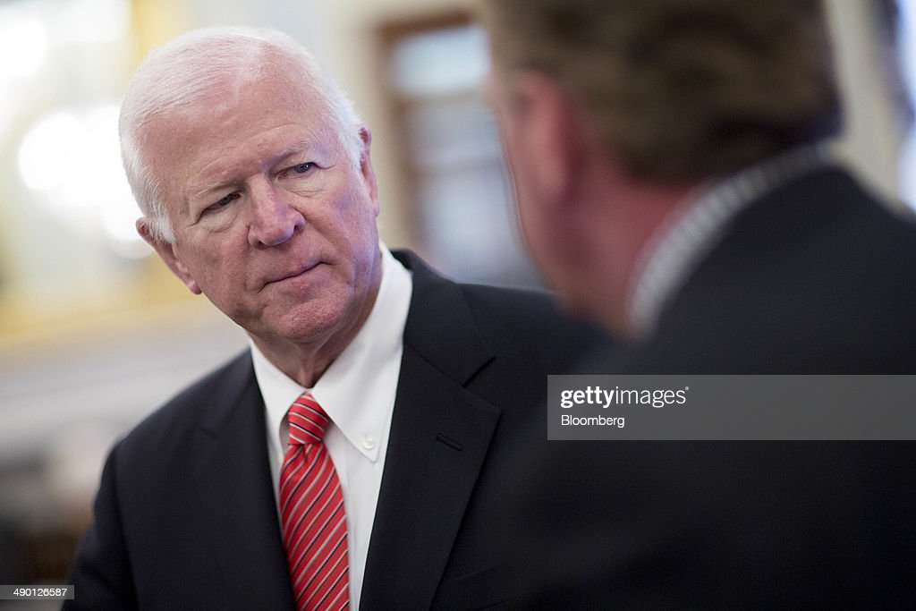 Senator Saxby Chambliss, a Republican from Georgia, left, talks to Terrence 'Terry' Duffy, chairman and president of CME Group Inc., before a Senate Agriculture Committee hearing in Washington, D.C., U.S., on Tuesday, May 13, 2014. High-speed trading in U.S. futures markets is being dominated by a small number of firms that should be forced to register with regulators to ensure adequate oversight, the Commodity Futures Trading Commission's former chief economist told lawmakers. Photographer: Andrew Harrer/Bloomberg via Getty Images