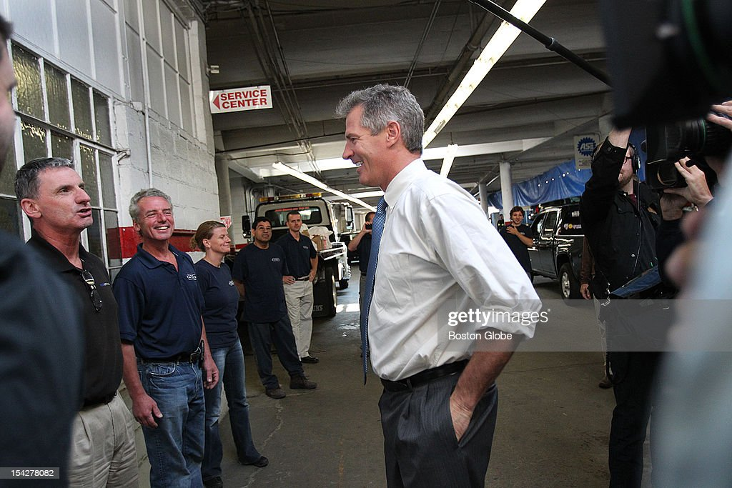 Senator Scott Brown brought coffee and donuts to owners and employees of Auto Service and Tire. He talks with one of the owners, Paul McKeen, on far left.