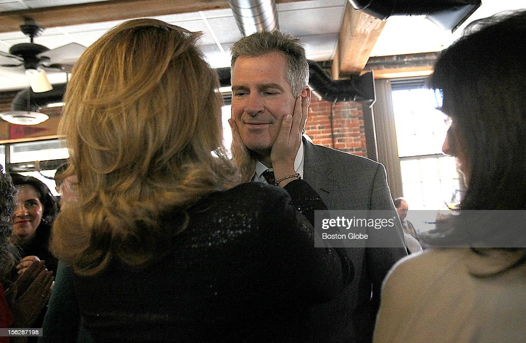 Senator Scott Brown campaigned at Stachey's Pizza where he received the endorsement of Laurie Myers, President of Community VOICES, a leading victims' advocacy organization in Massachusetts. He gets a hug and kiss from his wife, Gail Huff.