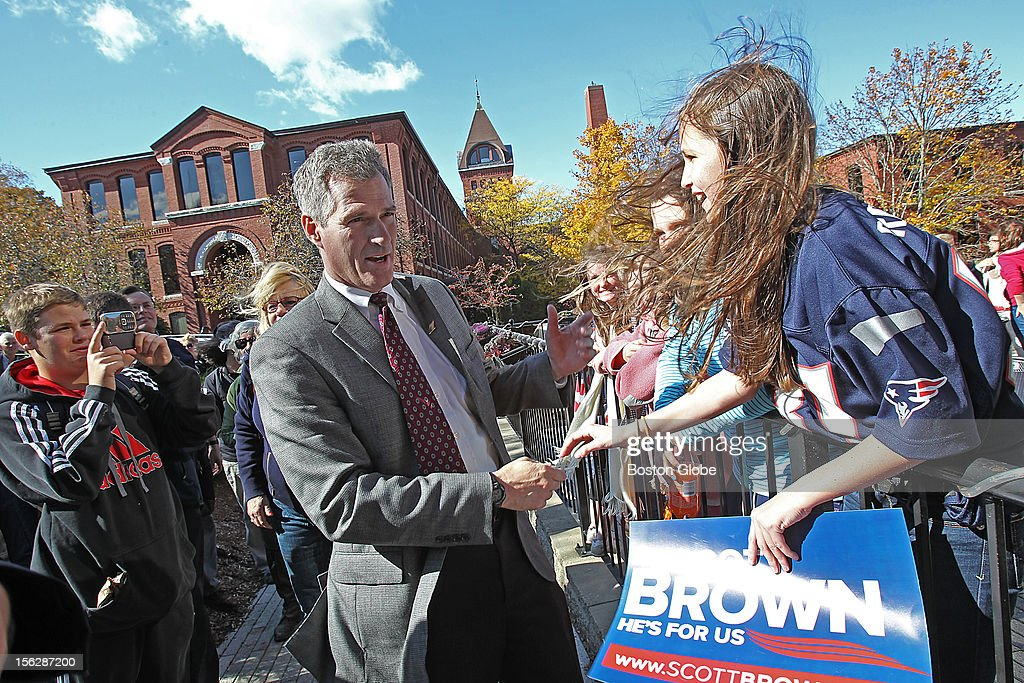 Senator Scott Brown campaigned at Stachey's Pizza where he received the endorsement of Laurie Myers, President of Community VOICES, a leading victims' advocacy organization in Massachusetts. He greets ten year old Shannon Gamble.