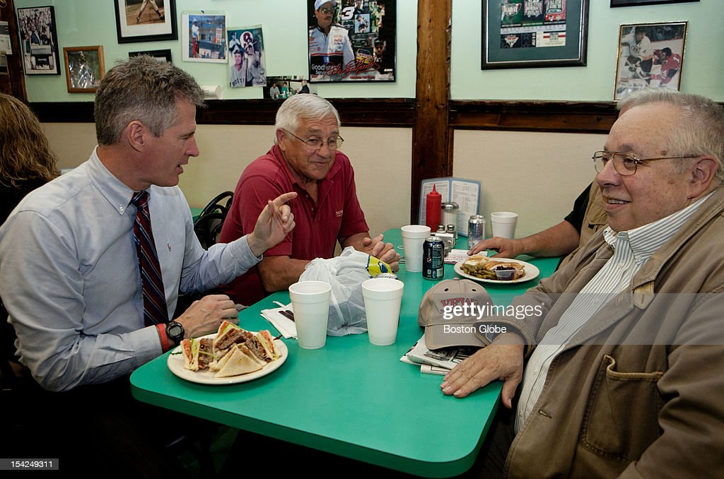 Senator Scott Brown dines with, left to right, Bill Dexter, Paul DeLuca, and Al Depaoli at Cousin's restaurant in Woburn, Massachusetts on October 15, 2012.