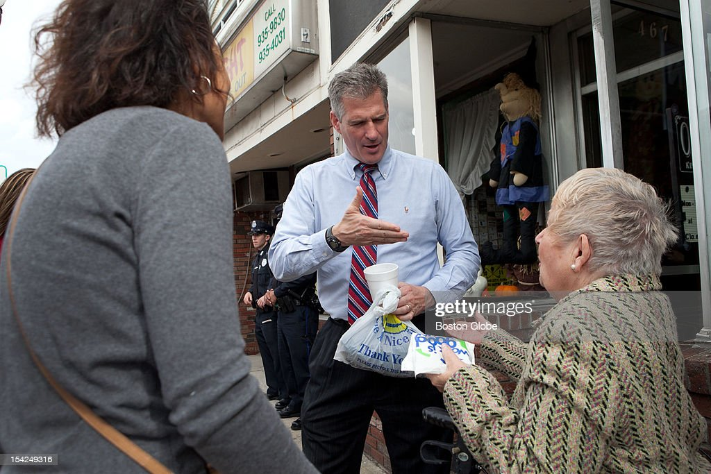 Senator Scott Brown greets supporters Carmen Kenrich, left, and Nancy Selvaggi, right, after he has lunch at Cousin's restaurant in Woburn, Massachusetts on October 15, 2012.