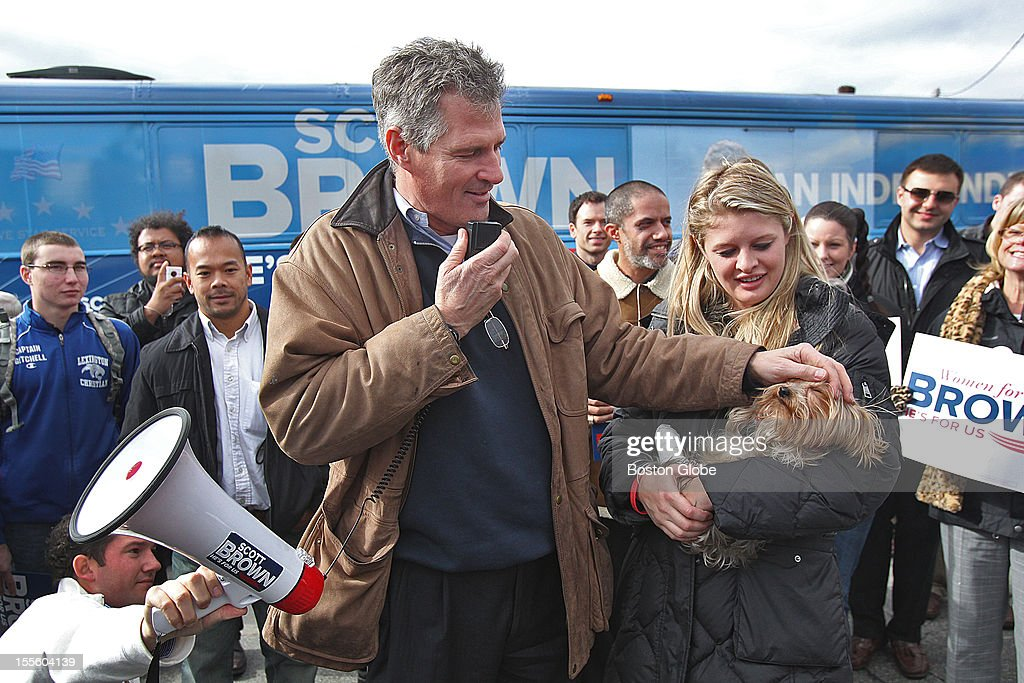 Senator Scott Brown makes a campaign stop at Moran Square Diner. His daughter, Arianna, brought one of their dogs, Koda, out for the speech in front of the diner.