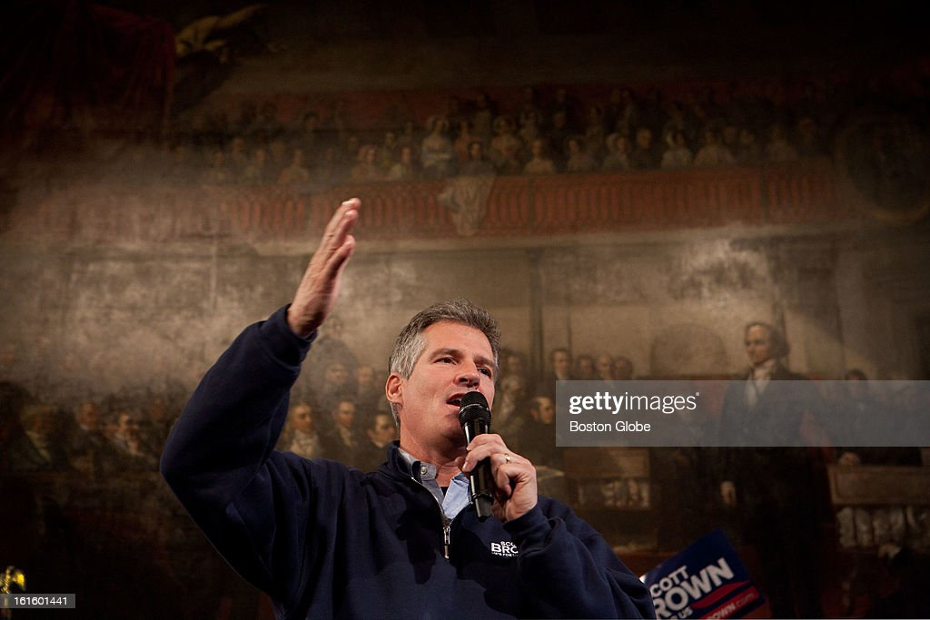 Senator Scott Brown speaks to the crowd during a rally at Faneuil Hall in Boston, Massachusetts on November 4, 2012.