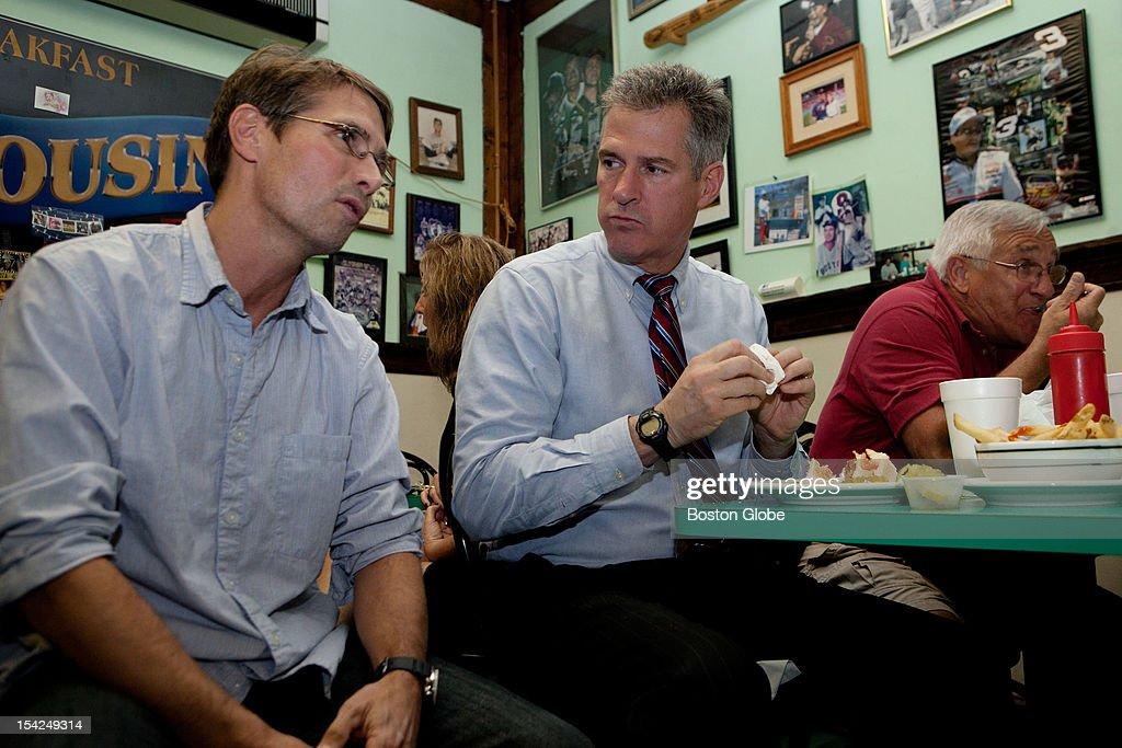 Senator Scott Brown speaks with Daniel Sabbatelli, left, as he has lunch with Bill Dexter, right, at Cousin's restaurant in Woburn, Massachusetts on October 15, 2012.