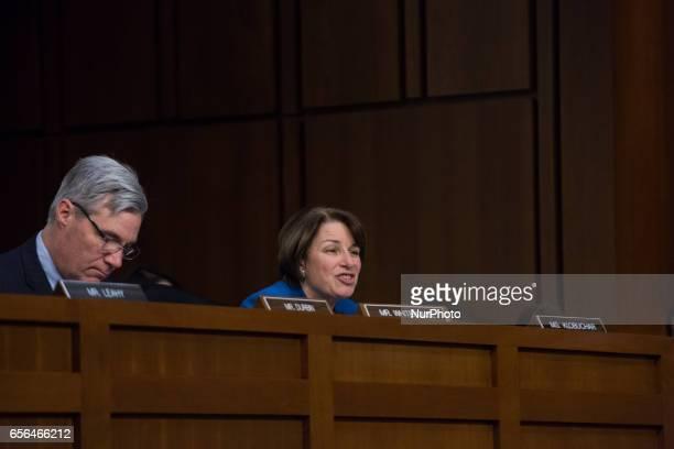 US Senator Sheldon Whitehouse listens as US Senator Amy Klobuchar questions President Trump's Supreme Court nominee Judge Neil Gorsuch on day two of...