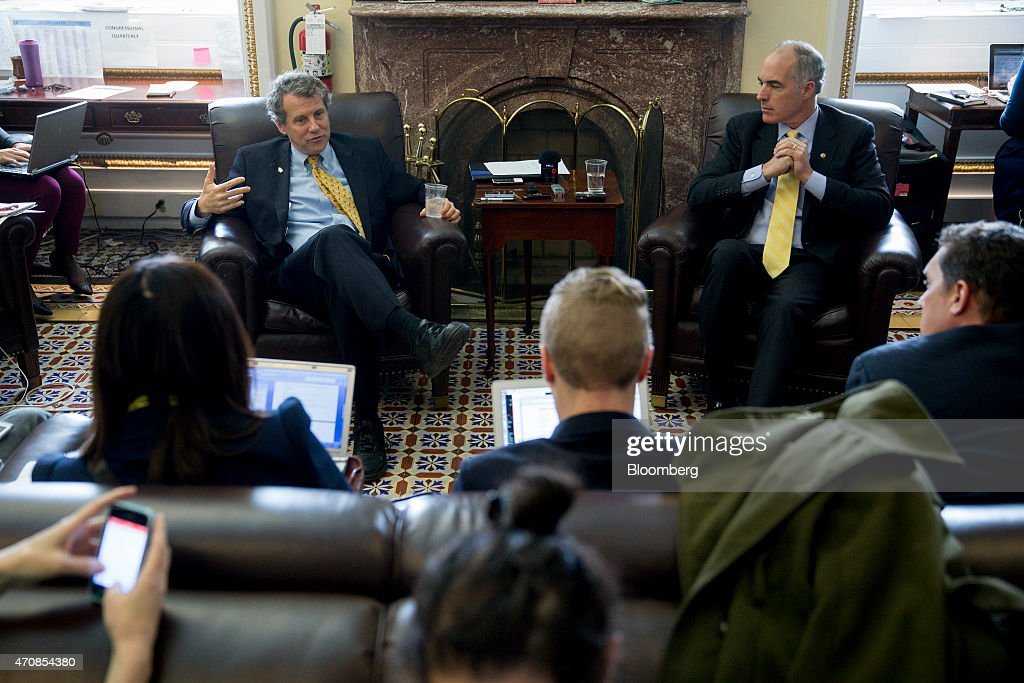Senator <a gi-track='captionPersonalityLinkClicked' href=/galleries/search?phrase=Sherrod+Brown&family=editorial&specificpeople=3986311 ng-click='$event.stopPropagation()'>Sherrod Brown</a>, a Democrat from Ohio, left, speaks to members of the media about the Trans-Pacific Partnership (TPP) with Senator Robert 'Bob' Casey, a Democrat from Pennsylvania, right, in the Senate Press Gallery at the U.S. Capitol in Washington, D.C., U.S., on Thursday, April 23, 2015. The Senate Finance Committee this week cleared in a 17-9 vote legislation to reauthorize federal assistance for workers whose jobs are threatened by foreign competition, a measure lawmakers said is intended to advance alongside a bipartisan bill that would streamline congressional approval of the controversial Trans-Pacific Partnership trade deal. Photographer: Andrew Harrer/Bloomberg via Getty Images