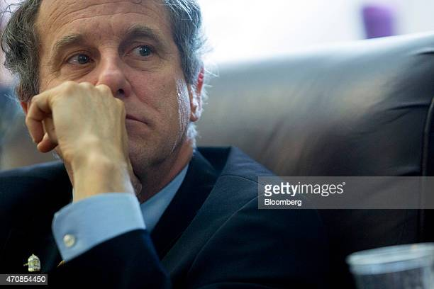 Senator Sherrod Brown a Democrat from Ohio listens to Senator Robert 'Bob' Casey a Democrat from Pennsylvania not pictured during a briefing with...