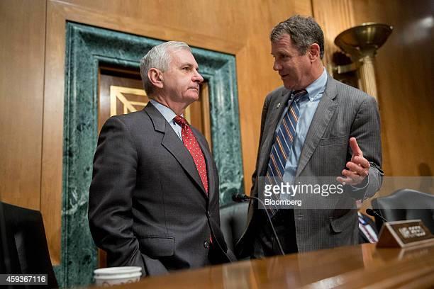 Senator Sherrod Brown a Democrat from Ohio right speaks with Senator Jack Reed a Democrat from Rhode Island while arriving to a Senate Banking...