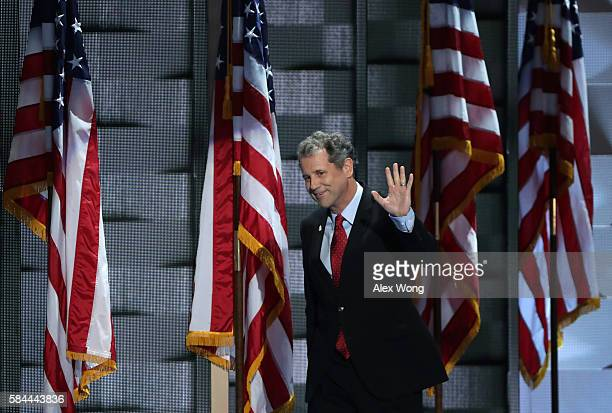 S Senator Sherrod Brown arrives on stage to deliver remarks on the fourth day of the Democratic National Convention at the Wells Fargo Center July 28...