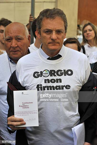 Senator Stefano Pedica with the Italian Constitution during the demonstration of the Party Italy of Values outside the Quirinal Palace to ask the...