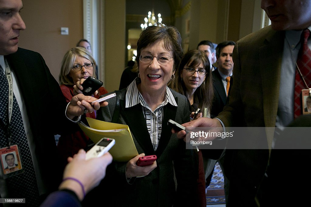 Senator <a gi-track='captionPersonalityLinkClicked' href=/galleries/search?phrase=Susan+Collins&family=editorial&specificpeople=212962 ng-click='$event.stopPropagation()'>Susan Collins</a>, a Republican from Maine, center, speaks to members of the media about fiscal negotiations at the U.S. Capitol in Washington, D.C., U.S., on Sunday, Dec. 30, 2012. Senate Majority Leader Harry Reid rejected the latest Republican offer to resolve the U.S. fiscal crisis as Minority Leader Mitch McConnell reached out to Vice President Joe Biden in an effort to break the impasse. Photographer: Andrew Harrer/Bloomberg via Getty Images