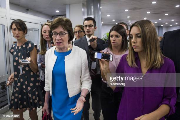 Senator Susan Collins a Republican from Maine second left speaks to members of the media near the Senate Subway in Washington DC US on Thursday July...