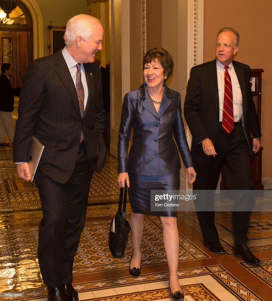 Senator Susan Collins center and Sen John Cornyn left walk through the halls of the US Capitol after a caucus meeting with fellow republicans...