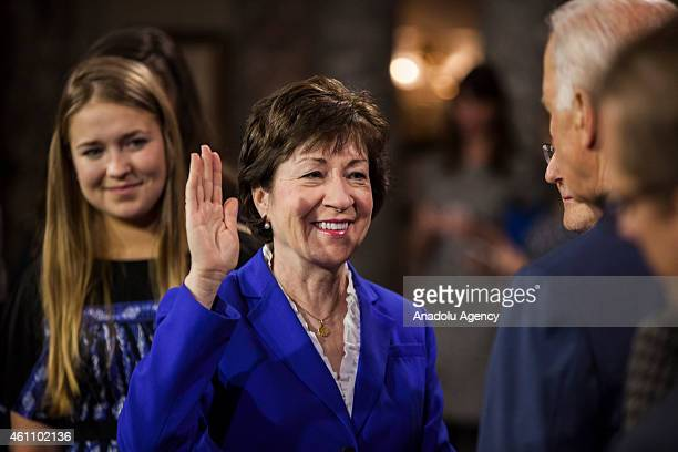 Senator Susan Collins reenacts her swearing in to the 114th US Congress with Vice President Joe Biden in Washington DC on January 6 2015