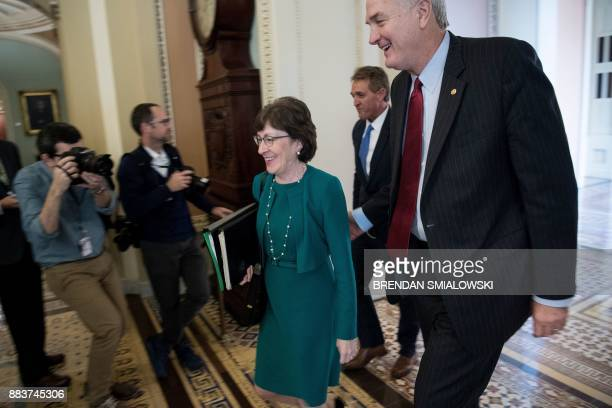 Senator Susan M Collins Senator Jeff Flake and Senator Luther Strange walk to the Senate floor on Capitol Hill December 1 2017 in Washington DC...