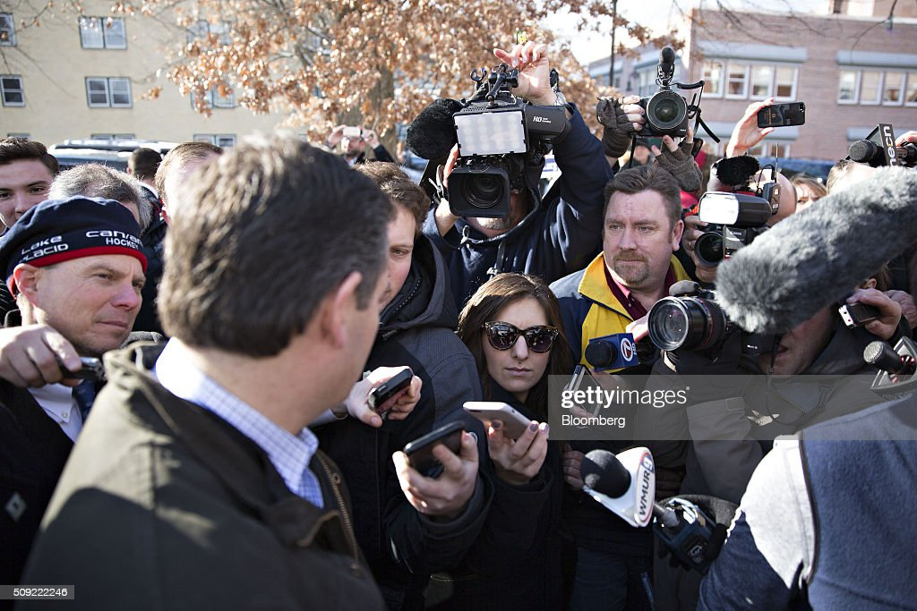 Senator Ted Cruz, a Republican from Texas and 2016 presidential candidate, left, speaks to the media while arriving at the Red Arrow Diner in Manchester, New Hampshire, U.S., on Tuesday, Feb. 9, 2016. Voters in New Hampshire took to the polls today in the nations first primary in the U.S. presidential race. Photographer: Daniel Acker/Bloomberg via Getty Images