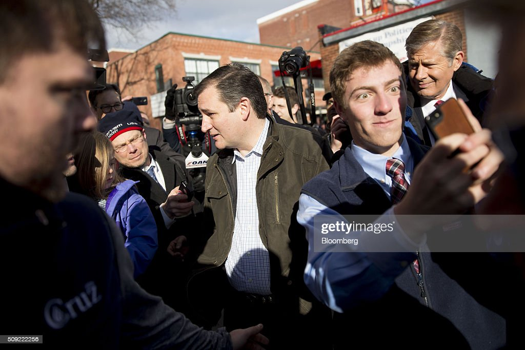 Senator Ted Cruz, a Republican from Texas and 2016 presidential candidate, center, speaks to the media while leaving the Red Arrow Diner in Manchester, New Hampshire, U.S., on Tuesday, Feb. 9, 2016. Voters in New Hampshire took to the polls today in the nations first primary in the U.S. presidential race. Photographer: Daniel Acker/Bloomberg via Getty Images