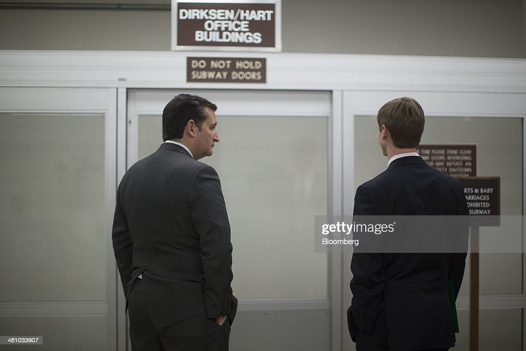 Senator <a gi-track='captionPersonalityLinkClicked' href=/galleries/search?phrase=Ted+Cruz&family=editorial&specificpeople=7222093 ng-click='$event.stopPropagation()'>Ted Cruz</a>, a Republican from Texas, left, waits for the Senate subway after voting on the nomination of Janet Yellen as chairman of the U.S. Federal Reserve in Washington, D.C., U.S., on Monday, Jan. 6, 2014. Yellen, currently Fed vice chairman, won U.S. Senate confirmation to become the 15th chairman of the Federal Reserve and the first woman to head the central bank in its 100-year history. Photographer: Andrew Harrer/Bloomberg via Getty Images