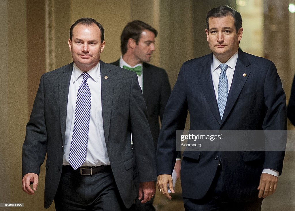 Senator <a gi-track='captionPersonalityLinkClicked' href=/galleries/search?phrase=Ted+Cruz&family=editorial&specificpeople=7222093 ng-click='$event.stopPropagation()'>Ted Cruz</a>, a Republican from Texas, right, and Senator Michael 'Mike' Lee, a Republican from Utah, walk to the Senate floor at the U.S. Capitol in Washington, D.C., U.S., on Wednesday, Oct. 16, 2013. The Senate voted 81-18 to halt the 16-day government shutdown and raise the U.S. debt limit, moving one step closer to ending the nation's fiscal impasse. Photographer: Pete Marovich/Bloomberg via Getty Images