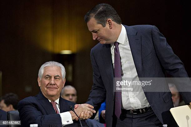 Senator Ted Cruz a Republican from Texas right shakes hands with Rex Tillerson former chief executive officer of Exxon Mobil Corp and US secretary of...