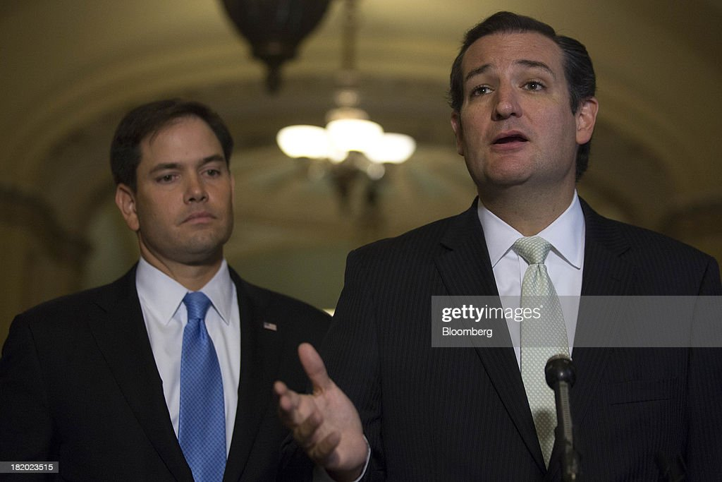 Senator <a gi-track='captionPersonalityLinkClicked' href=/galleries/search?phrase=Ted+Cruz&family=editorial&specificpeople=7222093 ng-click='$event.stopPropagation()'>Ted Cruz</a>, a Republican from Texas, right, speaks during a news conference with Senator <a gi-track='captionPersonalityLinkClicked' href=/galleries/search?phrase=Marco+Rubio+-+Politician&family=editorial&specificpeople=11395287 ng-click='$event.stopPropagation()'>Marco Rubio</a>, a Republican from Florida, following a vote in Washington, D.C., U.S., on Friday, Sept. 27, 2013. The U.S. Senate voted to finance the government through Nov. 15 after removing language to choke off funding for the health care law, putting pressure on the House to avoid a federal shutdown set to start Oct. 1. Photographer: Andrew Harrer/Bloomberg via Getty Images