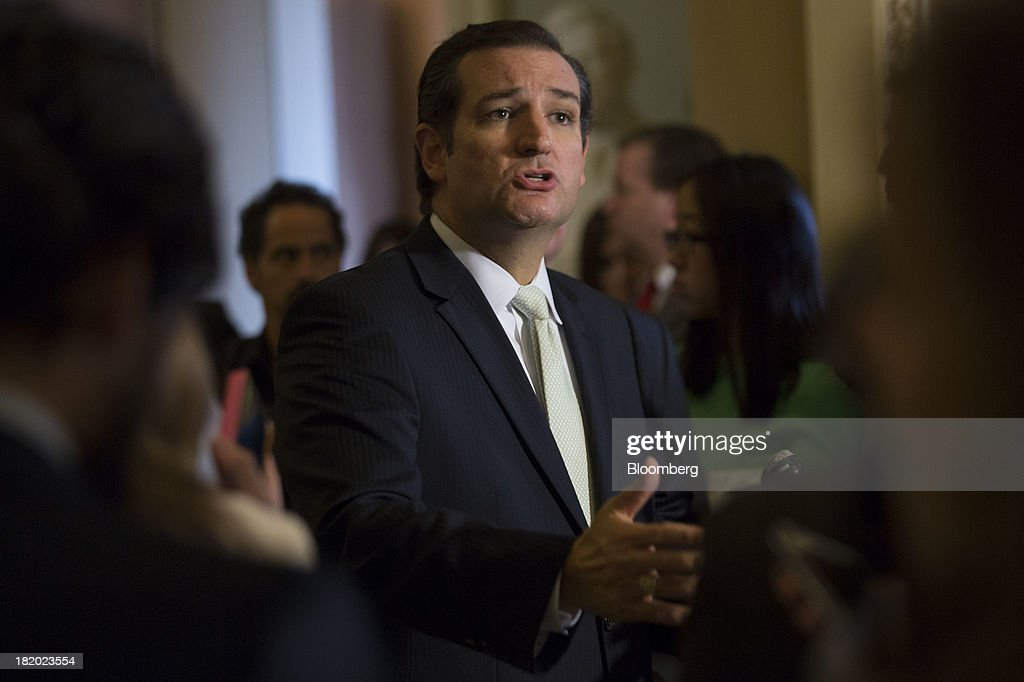Senator <a gi-track='captionPersonalityLinkClicked' href=/galleries/search?phrase=Ted+Cruz&family=editorial&specificpeople=7222093 ng-click='$event.stopPropagation()'>Ted Cruz</a>, a Republican from Texas, speaks during a news conference with Senator <a gi-track='captionPersonalityLinkClicked' href=/galleries/search?phrase=Marco+Rubio+-+Politician&family=editorial&specificpeople=11395287 ng-click='$event.stopPropagation()'>Marco Rubio</a>, not seen, following a vote in Washington, D.C., U.S., on Friday, Sept. 27, 2013. The U.S. Senate voted to finance the government through Nov. 15 after removing language to choke off funding for the health care law, putting pressure on the House to avoid a federal shutdown set to start Oct. 1. Photographer: Andrew Harrer/Bloomberg via Getty Images