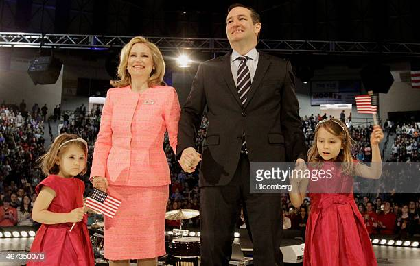 US Senator Ted Cruz a Republican from Texas stands with his wife Heidi Nelson Cruz and daughters Catherine Cruz left and Caroline Cruz right as he...