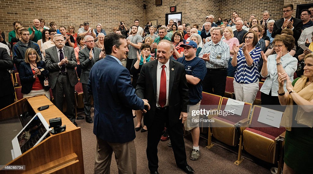Senator Ted Cruz and Representative Steve King shake hands during a town hall meeting at the Lincoln Center on the campus of Morningside College...
