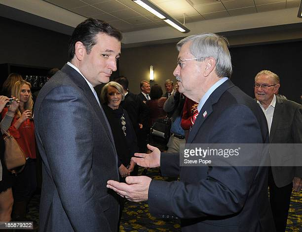 S Senator Ted Cruz greets Iowa Gov Terry Branstad prior to speaking at the annual Ronald Reagan Commemorative Dinner October 25 2013 in Des Moines...