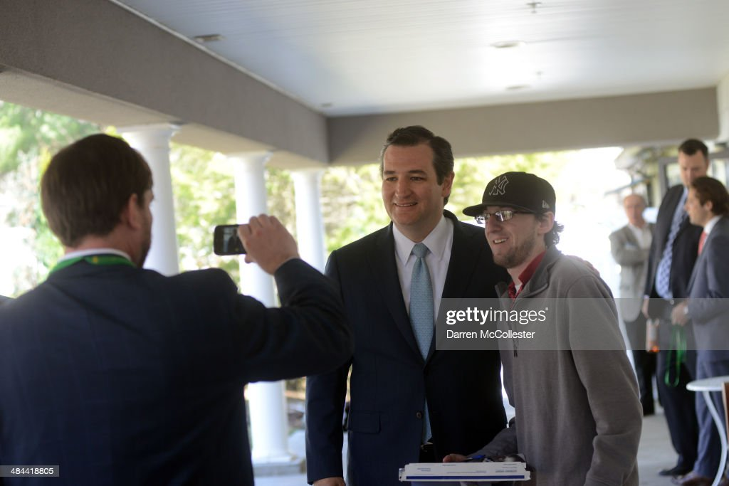 U.S. Senator <a gi-track='captionPersonalityLinkClicked' href=/galleries/search?phrase=Ted+Cruz&family=editorial&specificpeople=7222093 ng-click='$event.stopPropagation()'>Ted Cruz</a> (R-TX) has his picture taken outside the Freedom Summit at The Executive Court Banquet Facility April 12, 2014 in Manchester, New Hampshire. The Freedom Summit held its inaugural event where national conservative leaders bring together grassroots activists on the eve of tax day. Photo by Darren McCollester/Getty Images)