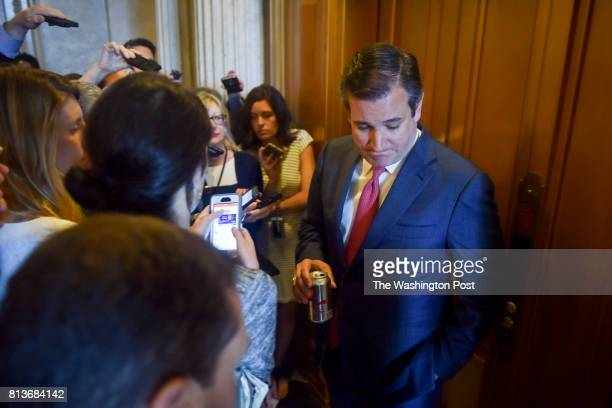 Senator Ted Cruz is hounded by reporters as Republican senators are questioned about the latest healthcare bill developments in the US Capitol on...