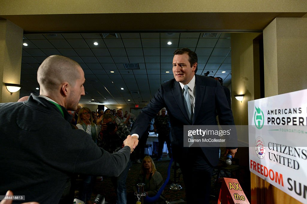 U.S. Senator Ted Cruz (R-TX) shakes hands with supporters after speaking at the Freedom Summit at The Executive Court Banquet Facility April 12, 2014 in Manchester, New Hampshire. The Freedom Summit held its inaugural event where national conservative leaders bring together grassroots activists on the eve of tax day. Photo by Darren McCollester/Getty Images)